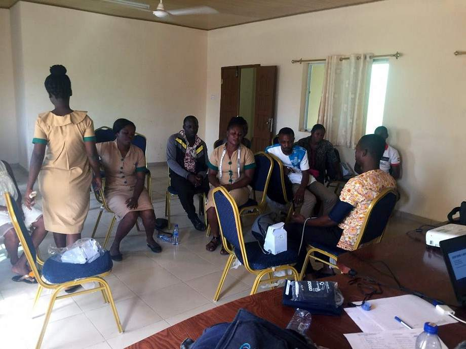 Community Health workers sitting in a room for training.